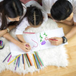 Family drawing together to celebrate Month of the Military Child